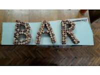 Sign for a bar at a wedding or party, handmade from wine corks