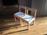 2 wooden children's Ikea chairs