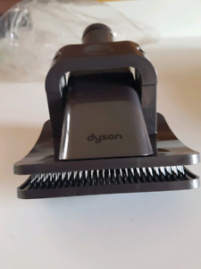 Never used. Still in package Dyson Grooming Tool