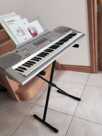 Casio CTK-800 Electric Keyboard, also included is a microphone, microphone stand and music stand