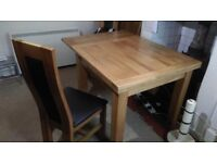 Solid Oak Extending dining table with 6 oak / leather chairs