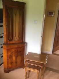 Small nest of yew veneered tables and corner display cabinet with cupboard below