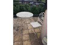 Garden table and four chairs, cream metal