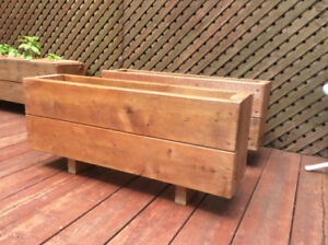 Handmade wooden stained flower box planter.