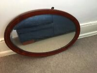 Oval mirror. 67cm x 46cm. £25 only . Wooden frame