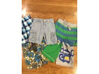 Five pairs of boys shorts aged 12-18 months
