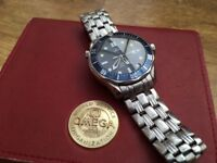 Omega seamaster full size watch with box, warranty card and spare links