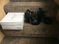 Brand new size 5 high heel sandles /block style heel ..