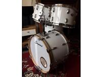 Slingerland 1970s maple drum kit with upgraded bass drum hoops and white cortex wrap