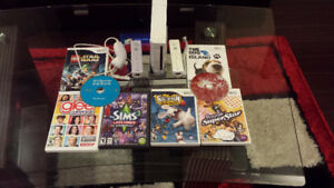 Nintendo Wii console with 8 games and two remotes