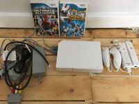 Nintendo wii console + 2 games 2 controls 2 nunchuks all leads/cables