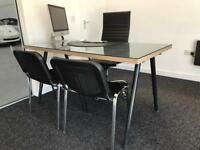 Glass top office desk with adjustable legs