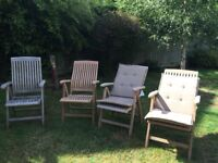 Solid Teak reclining garden chairs with detachable cushion covers. Good quality, 1 used and 3 unused