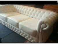 Large white chesterfield leather sofa