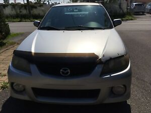 Mazda Protegé 2002 ES, faite vos offres.