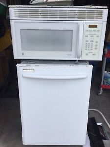 Microwave and dishwasher and  a kitchen radio and CD player