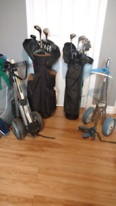 Two sets of right golf clubs with bag and stand