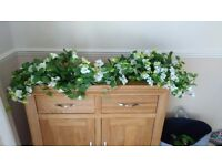 Large bag of artificial flowers, great for wedding venue decorations