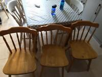 Four wooden chairs