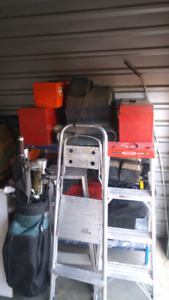 Variety of tool boxes all filled with toola
