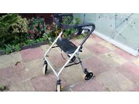 Disability Rollator with seat and brakes folds flat