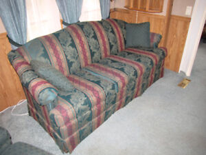 Striped camel back couch