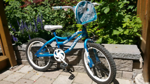 Girl's Bicycle with helmet and training wheels
