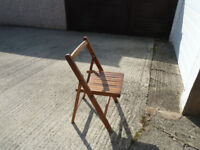 Four matching wooden folding chairs