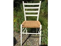 Pretty chair with woven sea grass seat and painted wood.