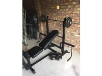 Fold away weight bench and iron weights 64kg ,gym