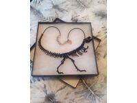 Tatty Devine - Dinosaur skeleton necklace