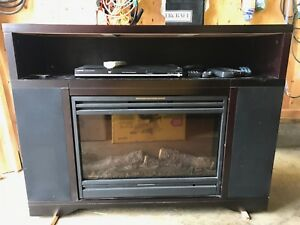 Electric fireplace with speakers