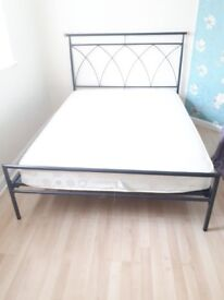 Black double iron bed with mattress