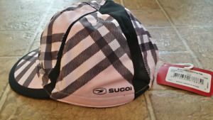 Sugoi. Braveheart. Cycling cap. Pink and black plaid design.