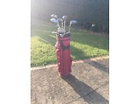Half set golf clubs and bag