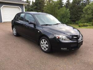 WOW! 2009 Mazda Mazda3 GX Hatchback 3