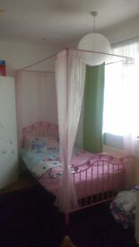 Girls four poster bed with mattress