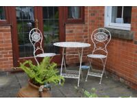 Lovely Cast iron table and 2 chairs