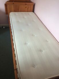 Single bed with addition slide out single stored underneath