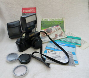 VINTAGE CANON SLR T 70 with ACCESSORIES