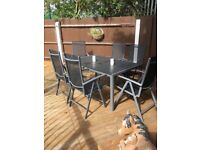 Garden table with 6 reclining chairs