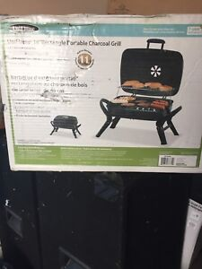 Brand new in box charcoal BBQ with new bag charcoal!