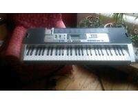 Casio KT- 100 keyboard, light up keys, in box with stand. BARGAIN!