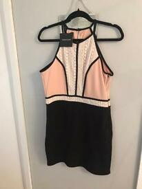 pink and black halter neck dress