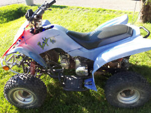 Kids atv 90 c.c and 2 motors for parts