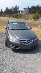 2008 Acura TL with Nav System. Summer & Winter tires.