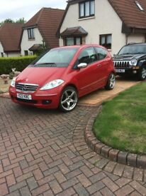 RED MERCEDES A CLASS WITH ALLOYS