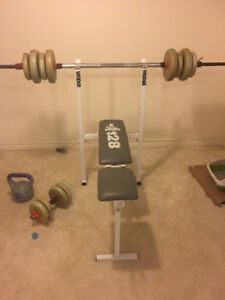 Weight bench with weights and 2 kettlebells