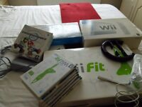 Wii Console plus Wii fit board,games and accessories
