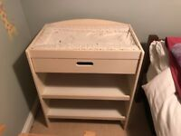 Changing table with storage space and drawer